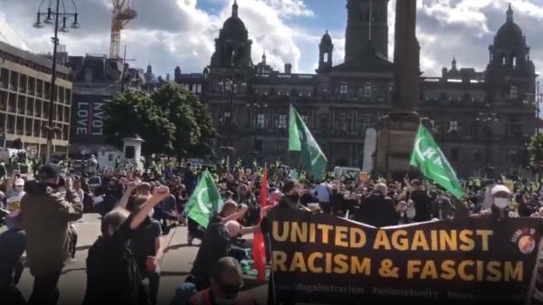 peaceful anti fascisim and antiracisim activists protest and glasgow